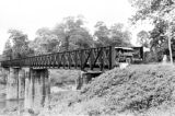 Vietnam, military vehicle crossing steel bridge during First Indochina War