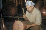 Baghdad (Iraq), man working on metal vessel