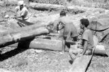 Indonesia, men cutting lumber for construction at Ruteng mission