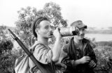Vietnam, French Navy sailors drinking wine during sweep of island in Ha Long Bay