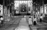 Indonesia, boys praying inside Ruteng church