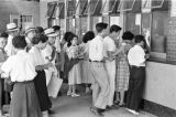 Japan, people lined up at ticket book at Tokyo railway station