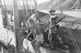 Vietnam, French Navy Commandos on boat docked in Ha Long Bay