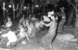Indonesia, Balinese dancers entertaining Western tourists at sarong party in Bali