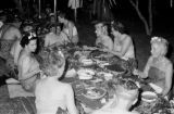 Indonesia, Western tourists eating meal at sarong party in Bali