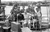 Indonesia, group portrait of Harrison Forman and escorts docked at Sumbawa Island