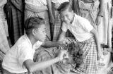 Indonesia, boy cutting another boy's hair at Ruteng mission