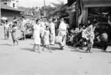 Indonesia, pedestrians walking past shops in Banjarmasin