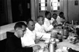 Indonesia, Bishop Willem van Bekkum and clergy dining at Ruteng mission