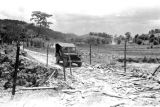 Vietnam, jeep passing bomb crater during First Indochina War