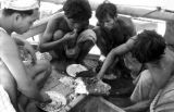 Indonesia, crew eating fish caught while sailing from Bima to Komodo Island