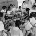India, school girls sitting around for meal in Mumbai
