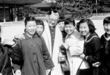 Japan, Western woman posing for photo with girls at Heian Jingu Shrine in Kyoto