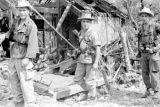 Vietnam, French troopers passing war damaged building during First Indochina War
