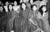 Indonesia, village girls watching outdoor movie at Ruteng mission