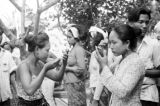 Indonesia, dancers putting on makeup for performance in Bali