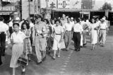 Japan, American military and Japanese pedestrians walking in Tokyo