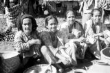 Indonesia, women selling goods at market on Sumbawa Island