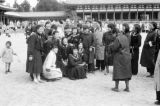 Japan, Japanese girls taking group photo with Western tourists at Heian Jingu Shrine in Kyoto