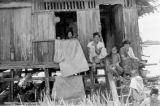 Indonesia, family at home on shore of Sumbawa Island