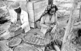 Indonesia, merchants making baskets to sell to Martapura diamond miners