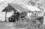 Indonesia, mail truck driving over covered bridge from Ruteng to Ende