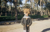 Baghdad (Iraq), boy carrying stack of flatbread on his head