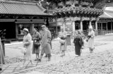 Japan, tourists walking past Yomei-mon gate at Toshogu Mausoleum in Nikko
