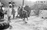 Indonesia, men using boiler to treat road on Sumbawa Island