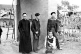 Vietnam, Father Joseph Yen and soldiers under blockhouse at Vinh Yen