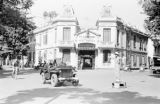 Vietnam, street scene with jeep in front of Hà Nội police station