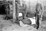 Vietnam, honor guards standing beside coffins of fallen comrades during First Indochina War
