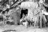 Indonesia, children in door of grass hut on Sumbawa Island