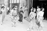 Japan, women in traditional Japanese and Western dress walking in Tokyo