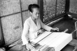 Indonesia, woman working at loom in Bali