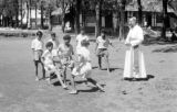 Indonesia, Bishop Willem van Bekkum watching boys play at Ruteng mission