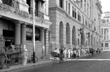 Singapore, pedestrians and carts along barricaded shops in Singapore