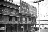 Philippines, Coca-Cola billboard above shops in Manila