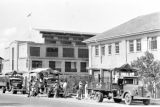 Singapore, trucks and military officers on road