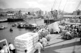 Philippines, passengers on busy pier at Manila Bay