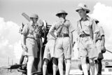 Singapore, Hong Kong and Singapore Royal Artillery men operating machinery