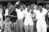 Indonesia, men smiling and waving