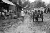 Indonesia, horse and carts making way through town