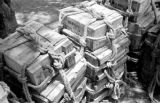 Laos, stacks of crates containing American aid in Xiangkhoang