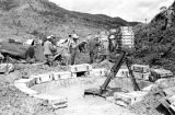 Laos, soldiers setting up ammunition crates near mortar in Xiangkhoang