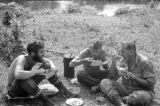 Malaysia, military personnel and Harrison Forman eating rations