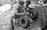 Malaysia, Republic of Fiji Military Forces soldiers fixing tire rims