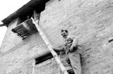 Vietnam, Harrison Forman ascending ladder of blockhouse during First Indochina War