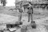 Vietnam, French officers conversing near rolled barbed wire in Vĩnh Phú province