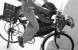 Indonesia, man using bicycle-powered sharpening wheel in Surabaya